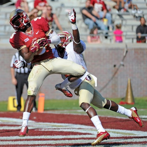 Apr 12, 2014; Tallahassee, FL, USA; Florida State Seminoles wide receiver Jesus Wilson (3) catches a touchdown pass past cornerback Nick Waisome (6) during the spring game at Doak Campbell Stadium. Mandatory Credit: Melina Vastola-USA TODAY Sports