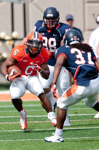 Apr 12, 2014; Champaign, IL, USA; Illinois Fighting Illini running back Josh Ferguson (6) runs with the ball as defensive back Davontay Kwaanig (37) defends during the second quarter of the spring game at Memorial Stadium. Mandatory Credit: Bradley Leeb-USA TODAY Sports