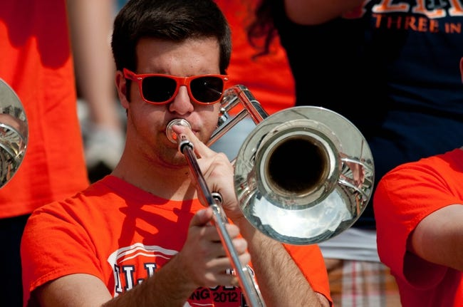 Apr 12, 2014; Champaign, IL, USA; A Illinois Fighting Illini band member plays from the stands during the third quarter of the spring game at Memorial Stadium. Mandatory Credit: Bradley Leeb-USA TODAY Sports