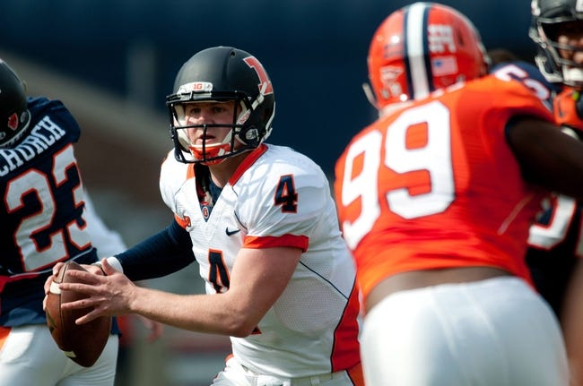Apr 12, 2014; Champaign, IL, USA; Illinois Fighting Illini quarterback Reilly O'Toole (4) runs with the ball during the third quarter of the spring game at Memorial Stadium. Mandatory Credit: Bradley Leeb-USA TODAY Sports