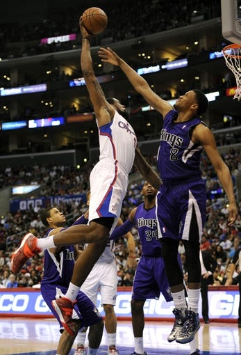 Apr 12, 2014; Los Angeles, CA, USA; Los Angeles Clippers center DeAndre Jordan (6) attempts to dunk the ball defended by Sacramento Kings forward Rudy Gay (8) during the fourth quarter at Staples Center. The Los Angeles Clippers won 117-101. Mandatory Credit: Kelvin Kuo-USA TODAY Sports