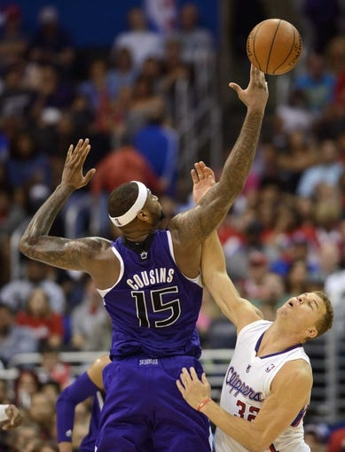 Apr 12, 2014; Los Angeles, CA, USA; Los Angeles Clippers forward Blake Griffin (32) steals the ball from Sacramento Kings center DeMarcus Cousins (15) during the fourth quarter at Staples Center. The Los Angeles Clippers won 117-101. Mandatory Credit: Kelvin Kuo-USA TODAY Sports