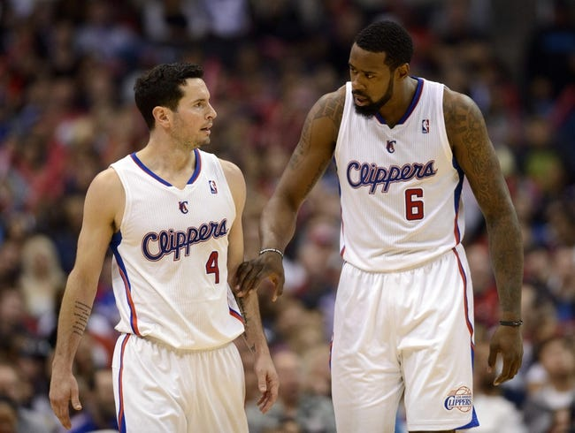Apr 12, 2014; Los Angeles, CA, USA; Los Angeles Clippers center DeAndre Jordan (6) talks to guard J.J. Reddick (4) after a foul was given to J.J. Reddick during the game against the Sacramento Kings during the fourth quarter at Staples Center. The Los Angeles Clippers won 117-101. Mandatory Credit: Kelvin Kuo-USA TODAY Sports