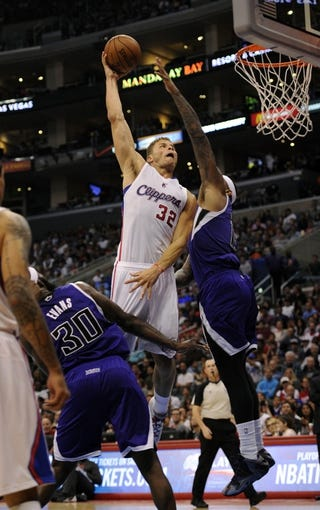 Apr 12, 2014; Los Angeles, CA, USA; Los Angeles Clippers forward Blake Griffin (32) goes up for a dunk over Sacramento Kings center DeMarcus Cousins (15) during the third quarter at Staples Center. The Los Angeles Clippers won 117-101. Mandatory Credit: Kelvin Kuo-USA TODAY Sports