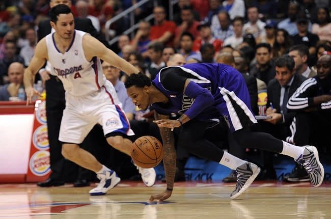 Apr 12, 2014; Los Angeles, CA, USA; Sacramento Kings guard Ben McLemore (16) moves the ball defended by Los Angeles Clippers guard J.J. Reddick (4) during the third quarter at Staples Center. The Los Angeles Clippers won 117-101. Mandatory Credit: Kelvin Kuo-USA TODAY Sports