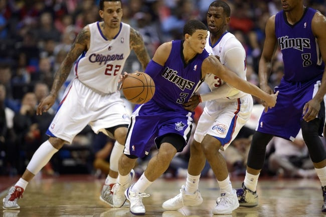 Apr 12, 2014; Los Angeles, CA, USA; Sacramento Kings guard Ray McCallum (3) moves the ball defended by Los Angeles Clippers guard Chris Paul (3) during the third quarter at Staples Center. The Los Angeles Clippers won 117-101. Mandatory Credit: Kelvin Kuo-USA TODAY Sports