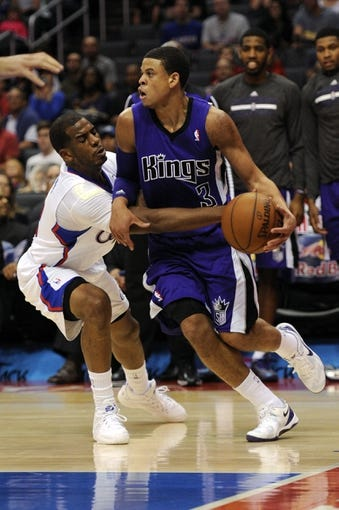 Apr 12, 2014; Los Angeles, CA, USA; Los Angeles Clippers guard Chris Paul (3) attempts to steal the ball from Sacramento Kings guard Ray McCallum (3) during the first quarter at Staples Center. Mandatory Credit: Kelvin Kuo-USA TODAY Sports