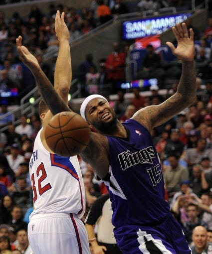 Apr 12, 2014; Los Angeles, CA, USA; Sacramento Kings center DeMarcus Cousins (15) loses the ball defended by Los Angeles Clippers forward Blake Griffin (32) during the second quarter at Staples Center. Mandatory Credit: Kelvin Kuo-USA TODAY Sports