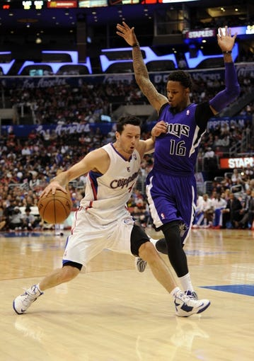 Apr 12, 2014; Los Angeles, CA, USA; Los Angeles Clippers guard J.J. Reddick (4) moves the ball defended by Sacramento Kings guard Ben McLemore (16) during the third quarter at Staples Center. The Los Angeles Clippers won 117-101. Mandatory Credit: Kelvin Kuo-USA TODAY Sports