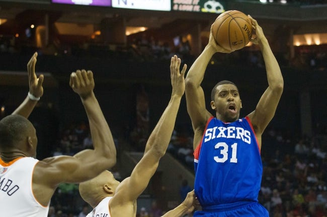 Apr 12, 2014; Charlotte, NC, USA; Philadelphia 76ers guard Hollis Thompson (31) passes the ball during the first half against the Charlotte Bobcats at Time Warner Cable Arena. Mandatory Credit: Jeremy Brevard-USA TODAY Sports