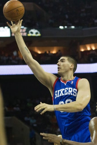 Apr 12, 2014; Charlotte, NC, USA; Philadelphia 76ers center Byron Mullens (30) shoots the ball during the first half against the Charlotte Bobcats at Time Warner Cable Arena. Mandatory Credit: Jeremy Brevard-USA TODAY Sports