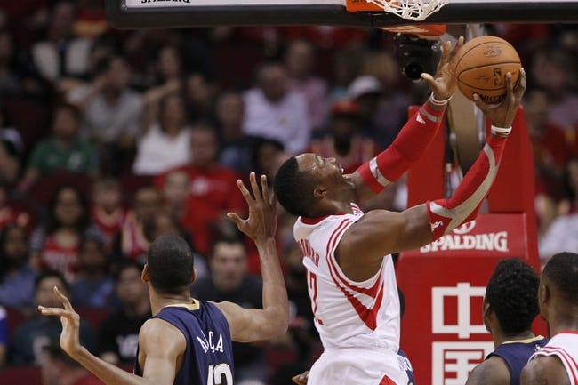 Apr 12, 2014; Houston, TX, USA; Houston Rockets guard Isaiah Canaan (1) drives to the basket past New Orleans Pelicans center Alexis Ajinca (42) during the first half at Toyota Center. Mandatory Credit: Soobum Im-USA TODAY Sports