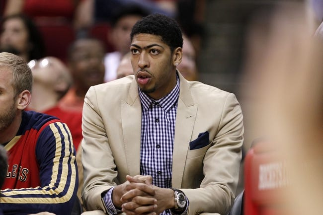 Apr 12, 2014; Houston, TX, USA; New Orleans Pelicans forward Anthony Davis watches from the bench during the first half against the New Orleans Pelicans at Toyota Center. Mandatory Credit: Soobum Im-USA TODAY Sports