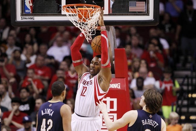 Apr 12, 2014; Houston, TX, USA; Houston Rockets center Dwight Howard (12) dunks the ball during the first half against the New Orleans Pelicans at Toyota Center. Mandatory Credit: Soobum Im-USA TODAY Sports