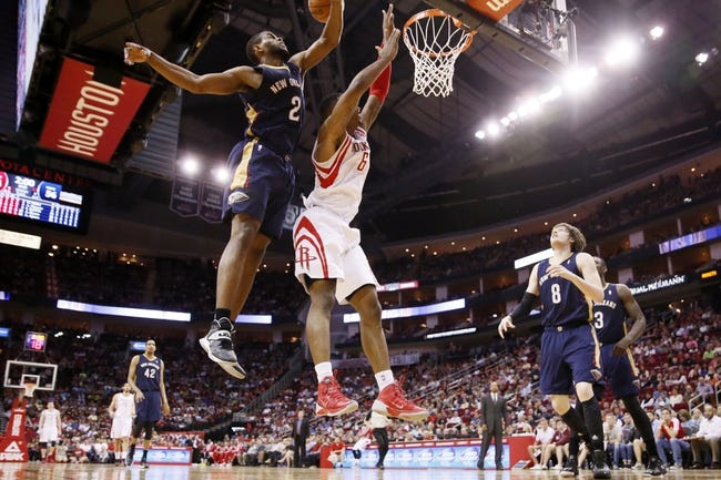 Apr 12, 2014; Houston, TX, USA; Houston Rockets forward Terrence Jones (6) has his shot blocked by New Orleans Pelicans forward Darius Miller (2) during the first half at Toyota Center. Mandatory Credit: Soobum Im-USA TODAY Sports
