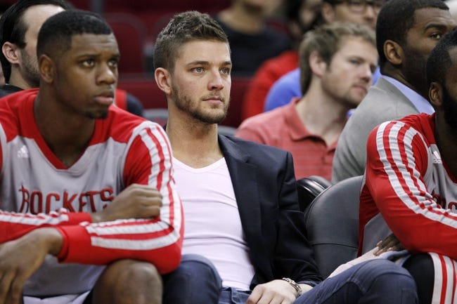Apr 12, 2014; Houston, TX, USA; Houston Rockets forward Chandler Parsons (suit) watches from the bench during the first half against the New Orleans Pelicans at Toyota Center. Mandatory Credit: Soobum Im-USA TODAY Sports