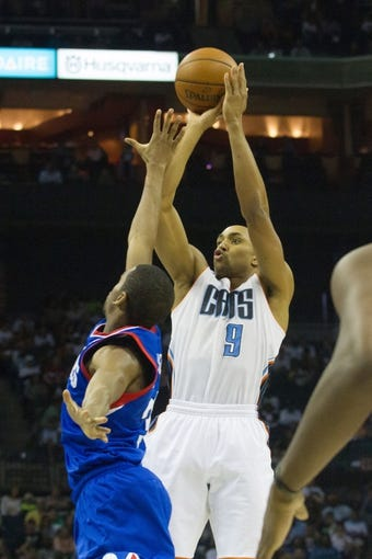Apr 12, 2014; Charlotte, NC, USA; Charlotte Bobcats guard Gerald Henderson (9) shoots a three point shot during the second half against the Philadelphia 76ers at Time Warner Cable Arena. The Bobcats defeated the 76ers 111-105. Mandatory Credit: Jeremy Brevard-USA TODAY Sports