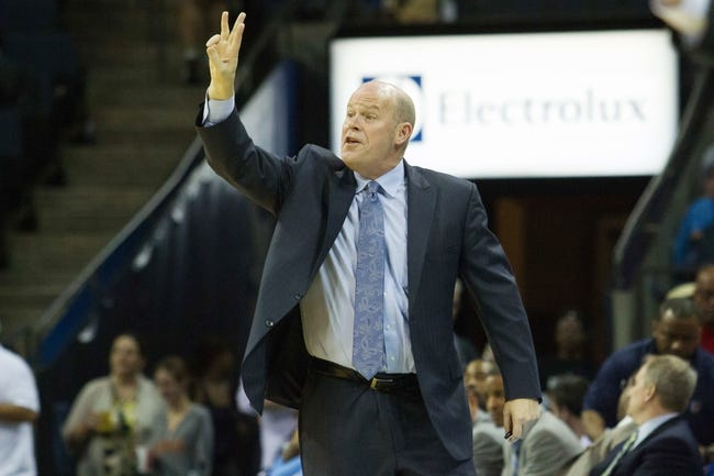 Apr 12, 2014; Charlotte, NC, USA; Charlotte Bobcats head coach Steve Clifford calls out during the second half against the Philadelphia 76ers at Time Warner Cable Arena. The Bobcats defeated the 76ers 111-105. Mandatory Credit: Jeremy Brevard-USA TODAY Sports