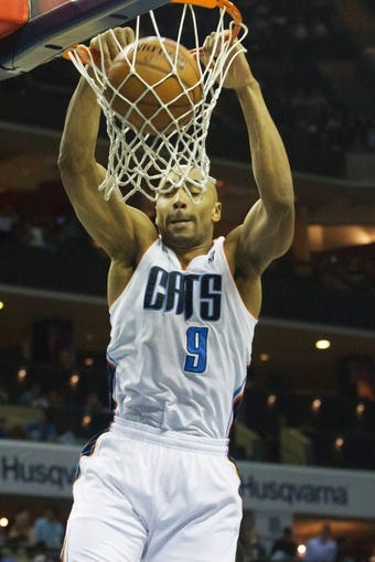 Apr 12, 2014; Charlotte, NC, USA; Charlotte Bobcats guard Gerald Henderson (9) dunks the ball during the second half against the Philadelphia 76ers at Time Warner Cable Arena. The Bobcats defeated the 76ers 111-105. Mandatory Credit: Jeremy Brevard-USA TODAY Sports