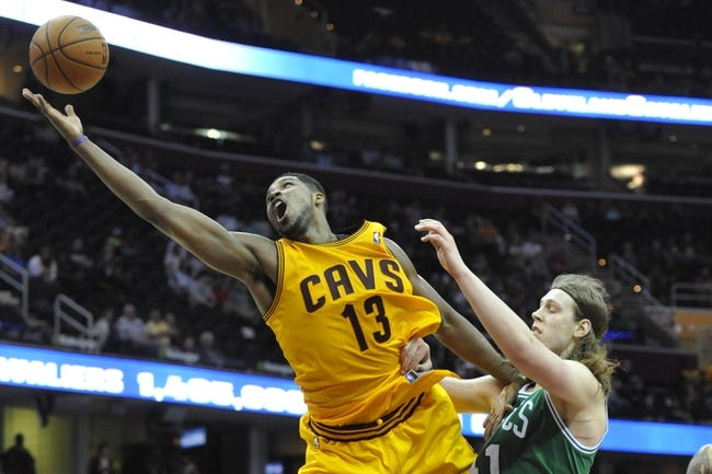 Apr 12, 2014; Cleveland, OH, USA; Cleveland Cavaliers forward Tristan Thompson (13) reaches for a pass against Boston Celtics center Kelly Olynyk (41) in the fourth quarter at Quicken Loans Arena. Mandatory Credit: David Richard-USA TODAY Sports