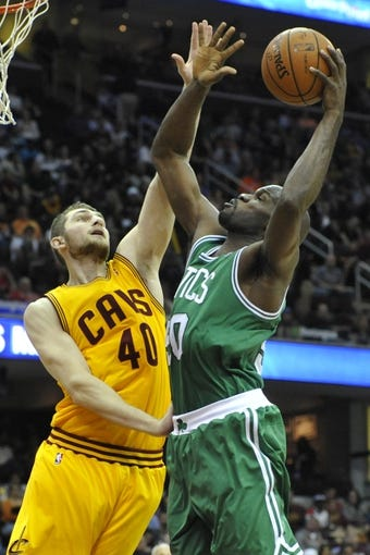Apr 12, 2014; Cleveland, OH, USA; Boston Celtics center Joel Anthony (50) shoots against Cleveland Cavaliers center Tyler Zeller (40) in the third quarter at Quicken Loans Arena. Mandatory Credit: David Richard-USA TODAY Sports