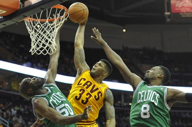Apr 12, 2014; Cleveland, OH, USA; Cleveland Cavaliers forward Alonzo Gee (33) dunks against Boston Celtics center Joel Anthony (50) and forward Jeff Green (8) in the fourth quarter at Quicken Loans Arena. Mandatory Credit: David Richard-USA TODAY Sports