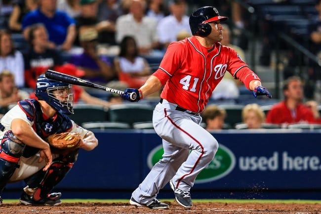 Apr 12, 2014; Atlanta, GA, USA; Washington Nationals catcher Sandy Leon (41) hits an RBI single in the eighth inning against the Atlanta Braves at Turner Field. Mandatory Credit: Daniel Shirey-USA TODAY Sports