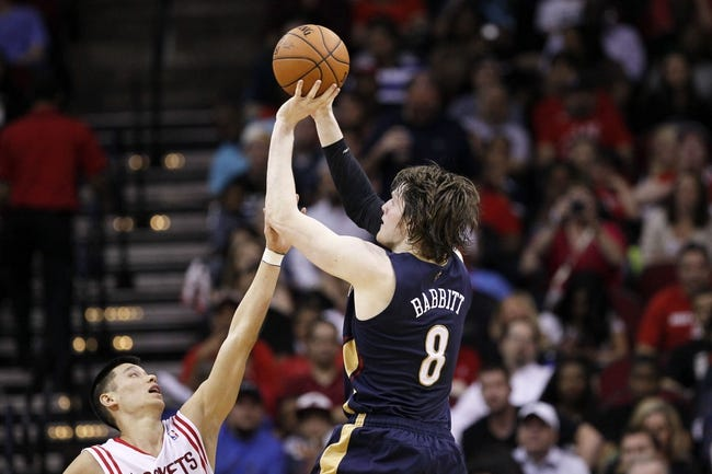 Apr 12, 2014; Houston, TX, USA; New Orleans Pelicans forward Luke Babbitt (8) shoots the ball over Houston Rockets guard Jeremy Lin (left) during the second half at Toyota Center. Mandatory Credit: Soobum Im-USA TODAY Sports
