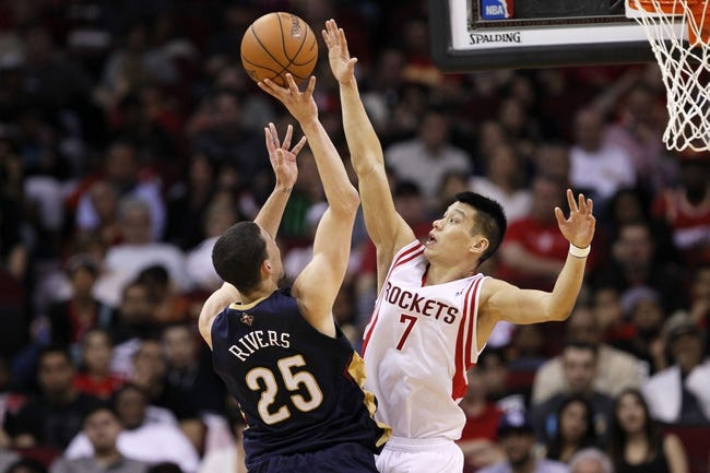 Apr 12, 2014; Houston, TX, USA; Houston Rockets forward Chandler Parsons (25) shoots the ball over Houston Rockets guard Jeremy Lin (7) during the second half at Toyota Center. Mandatory Credit: Soobum Im-USA TODAY Sports