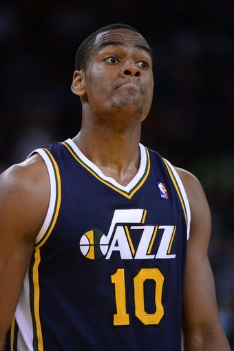 Apr 6, 2014; Oakland, CA, USA; Utah Jazz guard Alec Burks (10) reacts against the Golden State Warriors during the third quarter at Oracle Arena. The Warriors defeated the Jazz 130-102. Mandatory Credit: Kyle Terada-USA TODAY Sports