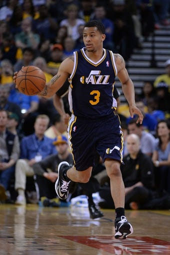 Apr 6, 2014; Oakland, CA, USA; Utah Jazz guard Trey Burke (3) dribbles the basketball against the Golden State Warriors during the third quarter at Oracle Arena. The Warriors defeated the Jazz 130-102. Mandatory Credit: Kyle Terada-USA TODAY Sports