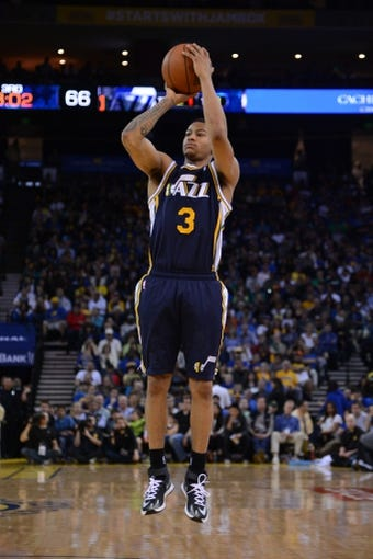 Apr 6, 2014; Oakland, CA, USA; Utah Jazz guard Trey Burke (3) shoots the basketball against the Golden State Warriors during the third quarter at Oracle Arena. The Warriors defeated the Jazz 130-102. Mandatory Credit: Kyle Terada-USA TODAY Sports