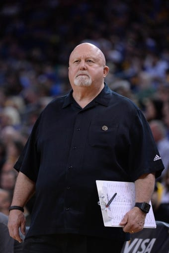 Apr 6, 2014; Oakland, CA, USA; Utah Jazz athletic trainer Gary Briggs looks on against the Golden State Warriors during the third quarter at Oracle Arena. The Warriors defeated the Jazz 130-102. Mandatory Credit: Kyle Terada-USA TODAY Sports