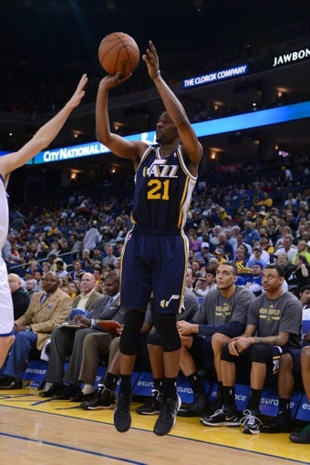 Apr 6, 2014; Oakland, CA, USA; Utah Jazz guard Ian Clark (21) shoots the basketball against the Golden State Warriors during the fourth quarter at Oracle Arena. The Warriors defeated the Jazz 130-102. Mandatory Credit: Kyle Terada-USA TODAY Sports