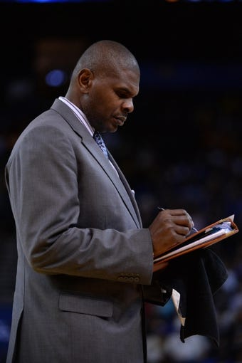 Apr 6, 2014; Oakland, CA, USA; Utah Jazz assistant coach Michael Sanders during the fourth quarter against the Golden State Warriors at Oracle Arena. The Warriors defeated the Jazz 130-102. Mandatory Credit: Kyle Terada-USA TODAY Sports