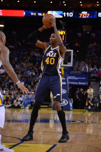 Apr 6, 2014; Oakland, CA, USA; Utah Jazz forward Jeremy Evans (40) controls the ball against the Golden State Warriors during the fourth quarter at Oracle Arena. The Warriors defeated the Jazz 130-102. Mandatory Credit: Kyle Terada-USA TODAY Sports