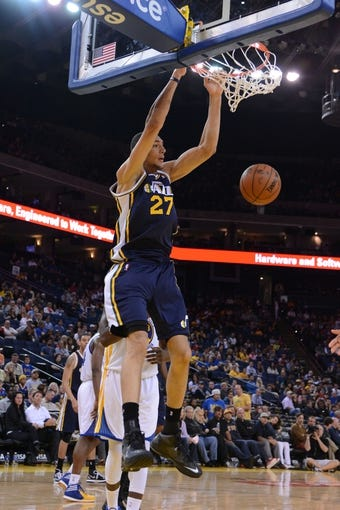 Apr 6, 2014; Oakland, CA, USA; Utah Jazz center Rudy Gobert (27) dunks the basketball against the Golden State Warriors during the fourth quarter at Oracle Arena. The Warriors defeated the Jazz 130-102. Mandatory Credit: Kyle Terada-USA TODAY Sports