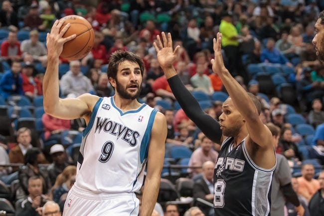 Apr 8, 2014; Minneapolis, MN, USA; Minnesota Timberwolves guard Ricky Rubio (9) passes behind his head at Target Center. Mandatory Credit: Brad Rempel-USA TODAY Sports