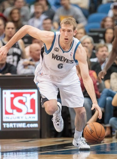 Apr 8, 2014; Minneapolis, MN, USA; Minnesota Timberwolves forward Robbie Hummel (6) dribbles at Target Center. Mandatory Credit: Brad Rempel-USA TODAY Sports