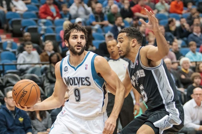 Apr 8, 2014; Minneapolis, MN, USA; Minnesota Timberwolves guard Ricky Rubio (9) dribbles against San Antonio Spurs guard Cory Joseph (5) at Target Center. Mandatory Credit: Brad Rempel-USA TODAY Sports
