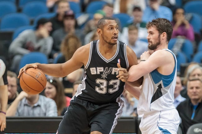 Apr 8, 2014; Minneapolis, MN, USA; San Antonio Spurs forward Boris Diaw (33) dribbles against Minnesota Timberwolves forward Kevin Love (42) at Target Center. Mandatory Credit: Brad Rempel-USA TODAY Sports