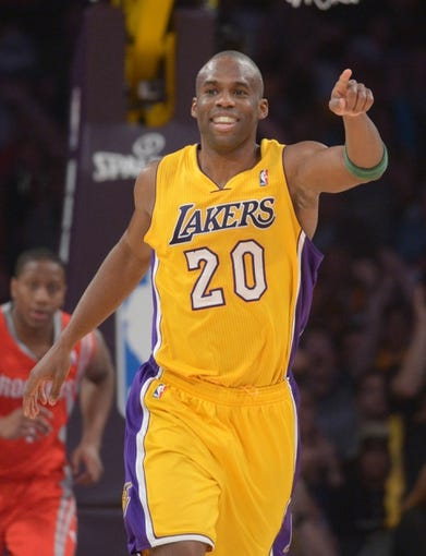 Apr 8, 2014; Los Angeles, CA, USA; Los Angeles Lakers guard Jodie Meeks (10) acknowledges Steve Nash (not pictured) after Meeks scored on assist by Nash to pass Mark Jackson (not pictured) to move into third on the all-time NBA assist list in the second quarter against the Houston Rockets at Staples Center. Mandatory Credit: Kirby Lee-USA TODAY Sports
