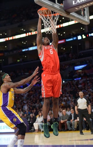 Apr 8, 2014; Los Angeles, CA, USA; Houston Rockers forward Terrence Jones (6) dunks the ball as Los Angeles Lakers forward Jordan Hill (27) defends at Staples Center. Mandatory Credit: Kirby Lee-USA TODAY Sports