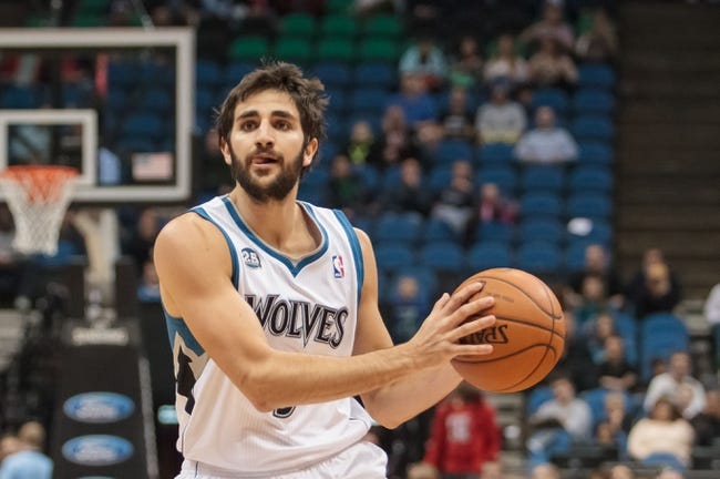 Apr 8, 2014; Minneapolis, MN, USA; Minnesota Timberwolves guard Ricky Rubio (9) passes at Target Center. Mandatory Credit: Brad Rempel-USA TODAY Sports