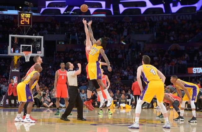 Apr 8, 2014; Los Angeles, CA, USA; General view of the opening tipoff between Houston Rockets center Omer Asik (3) and Los Angeles Lakers forward Jordan Hill (27) and referee Kane Fitzgerald watches at Staples Center. Mandatory Credit: Kirby Lee-USA TODAY Sports