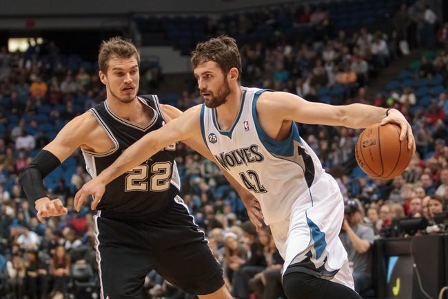 Apr 8, 2014; Minneapolis, MN, USA; Minnesota Timberwolves forward Kevin Love (42) dribbles against San Antonio Spurs center Tiago Splitter (22) at Target Center. Mandatory Credit: Brad Rempel-USA TODAY Sports