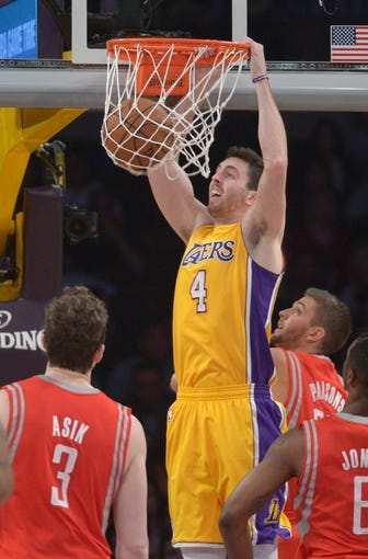 Apr 8, 2014; Los Angeles, CA, USA; Los Angeles Lakers forward Ryan Kelly (4) dunks the ball against the Houston Rockets at Staples Center. Mandatory Credit: Kirby Lee-USA TODAY Sports