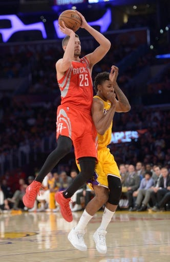 Apr 8, 2014; Los Angeles, CA, USA; Houston Rockets forward Chandler Parsons (25) is fouled by Los Angeles Lakers guard Nick Young (0) at Staples Center. Mandatory Credit: Kirby Lee-USA TODAY Sports