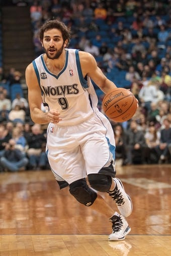 Apr 8, 2014; Minneapolis, MN, USA; Minnesota Timberwolves guard Ricky Rubio (9) dribbles at Target Center. Mandatory Credit: Brad Rempel-USA TODAY Sports