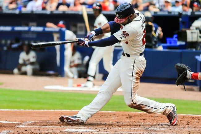 Apr 13, 2014; Atlanta, GA, USA; Atlanta Braves right fielder Jason Heyward (22) hits an RBI double in the second inning against the Washington Nationals at Turner Field. Mandatory Credit: Daniel Shirey-USA TODAY Sports